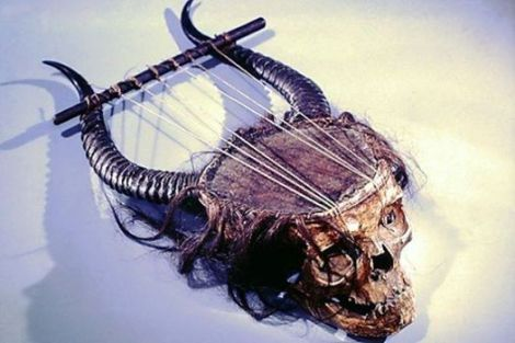 terrifically ghastly 19th century musical instrument -technical classification-Chordophone-Lyre-plucked- made from a human skull, antelope horns, skin, gut, and hair
