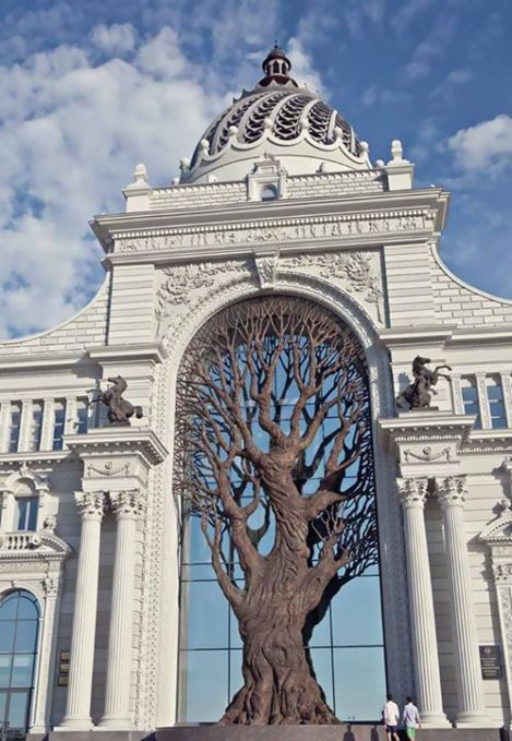 The ministry of agriculture in Kazan, Russia has a giant metal tree built in the center that casts a shadow over the archway.