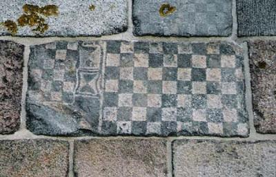 Chess Board and Time Glass on the Church wall. Checkerboard patterns can be found back into early christian churches and until the ancient Egyptians